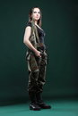 Army woman with gun beautiful woman with rifle plastic military girl holding green background Stock Images