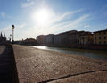 Arno river pisa buildings by the in italy Stock Image