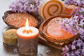 Aroma candle sea salt brown sugar natural soap and lilac flower Royalty Free Stock Photos