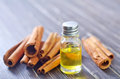 Aroma oil and cinnamon on a table Royalty Free Stock Photo