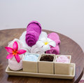 Aroma oil, facial cream, powder, towel on table Royalty Free Stock Photo
