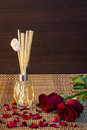 Aroma reed diffuser on wood pattern background setting with rose and rose patals backgruond Stock Photos