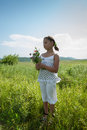 Aroma of summer little girl enjoys wild flowers Stock Image