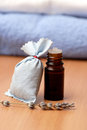 Aromatherapy bag of lavender and oil bottle close up Stock Image