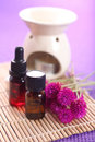 Aromatherapy bottle of essential oil burner and candles let s go spa Stock Photo