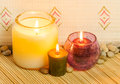 Aromatherapy candles closeup a image of set on a bed of bamboo used in in a spa Royalty Free Stock Photography