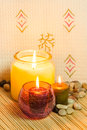 Aromatherapy candles an image of set on a bed of bamboo used in in a spa Stock Images