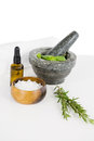 Aromatherapy oil with rosemary and mortar and pestle Royalty Free Stock Photo