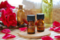 Aromatherapy oils for massage treatment at beauty salon with rose and natural cosmetics Stock Image