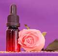 Aromatherapy one bottle of essential oil and rose flower on bamboo mat come on let s go spa Stock Photography