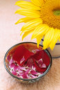 Aromatherapy petals, sunflower and towel Stock Photos