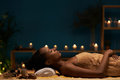 Aromatherapy treatment side view of woman having in spa salon Stock Photography