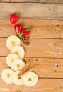 Aromatic apples sliced in a still life with cinnamon sticks Royalty Free Stock Image