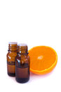 Aromatic essential oil and fresh orange Royalty Free Stock Photo