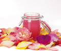 Aromatic rose water and petals Royalty Free Stock Images