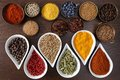 Aromatic spices flavorful colorful in metal and ceramic bowls on dark wooden background Royalty Free Stock Photos