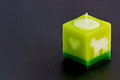 Arometic candle on black table Royalty Free Stock Photo
