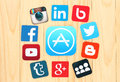 Around AppStore icon are placed famous social media icons