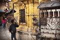 Around swayambhunath people rotate prayer wheels while making ritual circumambulation stupa ancient buddhist stupa in kathmandu Stock Photos