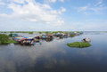 Around tonle sap waterside scenery with rural houses and boats at the a river in cambodia Royalty Free Stock Photo