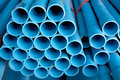 Arrange blue pipe in stock of pvc Stock Images
