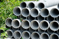 Arrange cement pipe near tree in warehouse Royalty Free Stock Image