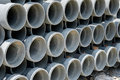 Arrange cement pipe in stock warehouse Royalty Free Stock Photo