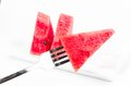 Arrange piece of fresh watermelon on dish with fork white background Royalty Free Stock Photography