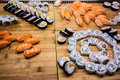 Arranged sushi a lot of rolls on a wooden surface in a restaurant Royalty Free Stock Images