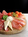 Arrangement of delicatessen cold cuts with smoked ham cheese pepperoni salami Royalty Free Stock Photos