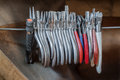 Arrangement of grippers hanging at the workbench a goldsmith Royalty Free Stock Image