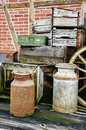 Arrangement of old stuff hdr metal milk barrel wooden boxes fruit cases and other vintage Royalty Free Stock Photography