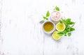 An arrangement of olive oil, himalayan salt, basil, lime and lemon Royalty Free Stock Photo