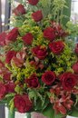 Arrangement of roses in a basket placed in market stall Royalty Free Stock Photo