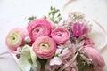 Arrangement spring flowers pale pink ribbon Stock Photos