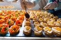 Arranging catering food specialities different for a special event Stock Photos