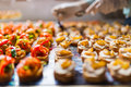 Arranging catering food specialties different for a special event Royalty Free Stock Images
