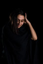 Arranging hair portrait of woman isolated on black background Royalty Free Stock Photos