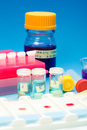 Array of blood samples for microscopy and biopsy tissue on blue gradient background Stock Photography