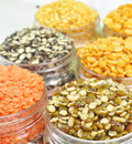 Array of pulses close up different types displayed in plastic container Royalty Free Stock Photography