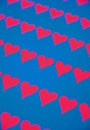 An array of red hearts on a blue background. Stock Images