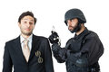Arrest a corrupted businessman being arrested by a swat agent Royalty Free Stock Image