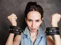 Arrest and jail. Criminal woman prisoner girl in handcuffs Royalty Free Stock Photo