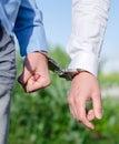 Arrest of an offender handcuffs Stock Photo