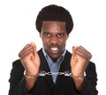 Arrested man with handcuffed hands young african isolated on white background Royalty Free Stock Image