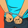 Arrested man in handcuffs pop art style vector