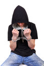 Arrested young man in handcuffs isolated on the white background Royalty Free Stock Photos