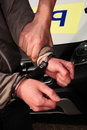 Arresting and detaining, handcuffs in action. Royalty Free Stock Image