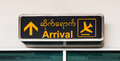 Arrival Airport Signs in Burmese and English, Mandalay Airport Royalty Free Stock Photo