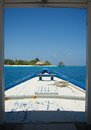 Arriving on a paradise island in the maldives dhoni landing mar by traditional boat Royalty Free Stock Photography